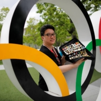 Olympic pin collectors lament loss of trading chances in Tokyo