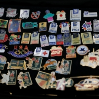 Mostly produced by media and sponsors and given to their staff, the rarest Olympics badges can fetch hundreds of dollars on auction websites. | REUTERS