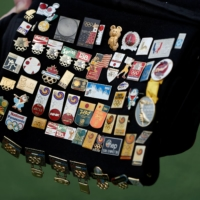 Yoshiyuki Terajima, 51, a pin collector based in Tokyo, shows his Olympic pin collection near the National Stadium in Tokyo on June 13. | REUTERS