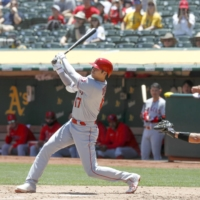 Shohei Ohtani connects on his 19th home run of the season during the second inning against the Athletics on Wednesday in Oakland, California.  | KYODO
