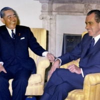 Prime Minister Eisaku Sato and U.S. President Richard Nixon hold talks at the White House in November 1969, during which they agreed on the return of Okinawa from the U.S. to Japan.  | KYODO