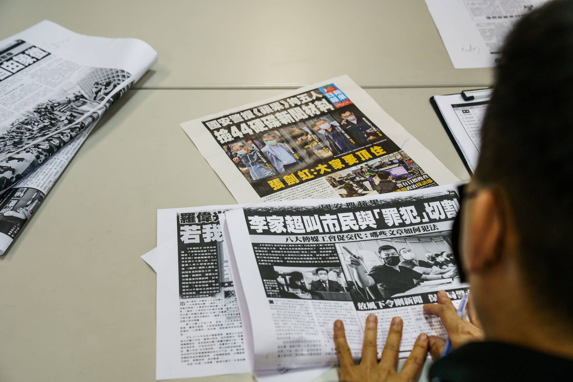 An employee works in the newsroom of the Apple Daily newspaper in Hong Kong on Thursday.   BLOOMBERG