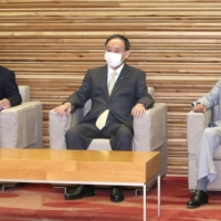 Prime Minister Yoshihide Suga attends a Cabinet meeting on Friday morning. The pandemic has devastated the economy for over a year, but it has also brought about drastic changes that could actually be strong assets for Suga's economic policy. | KYODO
