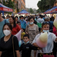 People walk through a night market during the May holidays tourist rush in Kashgar on May 2.   REUTERS