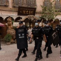 Police officers patrol in the old city in Kashgar on May 4.   REUTERS