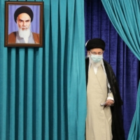 Iranian Supreme Leader Ayatollah Ali Khamenei arrives to cast his ballot Friday in the country's presidential election.    AFP-JIJI