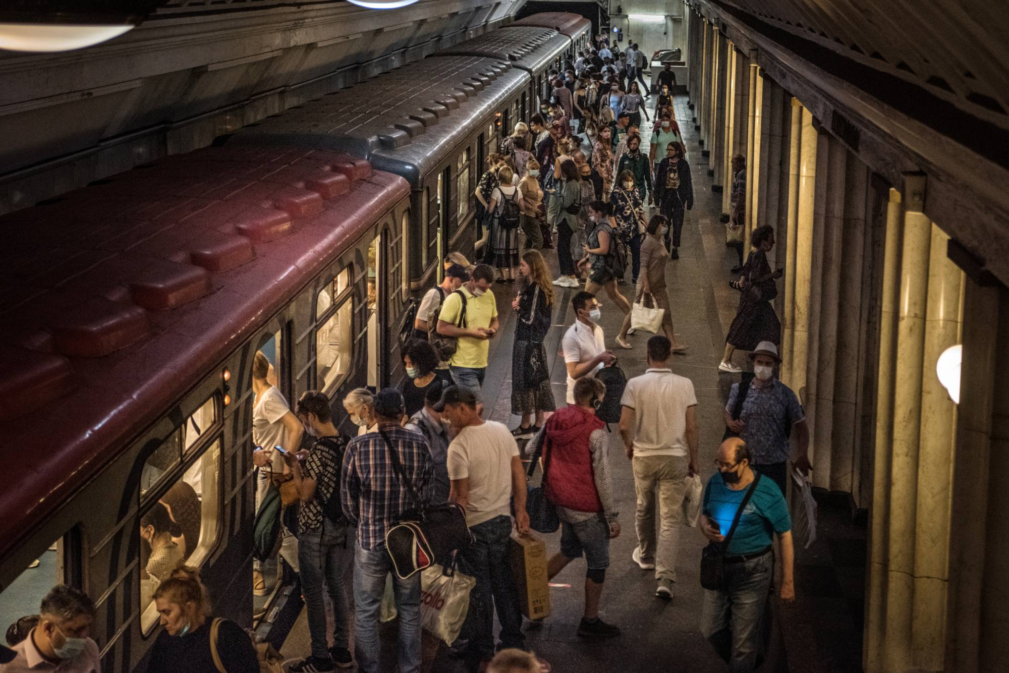 Subway commuters are seen Tuesday in Moscow, where the mayor said Friday that 89.3% of all new coronavirus cases there involve the highly contagious Delta variant.     SERGEY PONOMAREV/THE NEW YORK TIMES