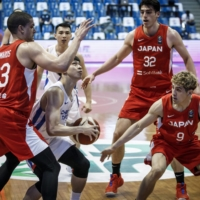 Gavin Edwards (23) and his teammates defend against Taiwan in their FIBA Asia Cup qualifying game on Friday in the Philippines. | COURTESY OF FIBA ASIA CUP