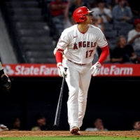 Los Angeles Angels designated hitter Shohei Ohtani hits a solo home run during the eighth inning against the Detroit Tigers at Angel Stadium.  | USA TODAY SPORTS / VIA REUTERS