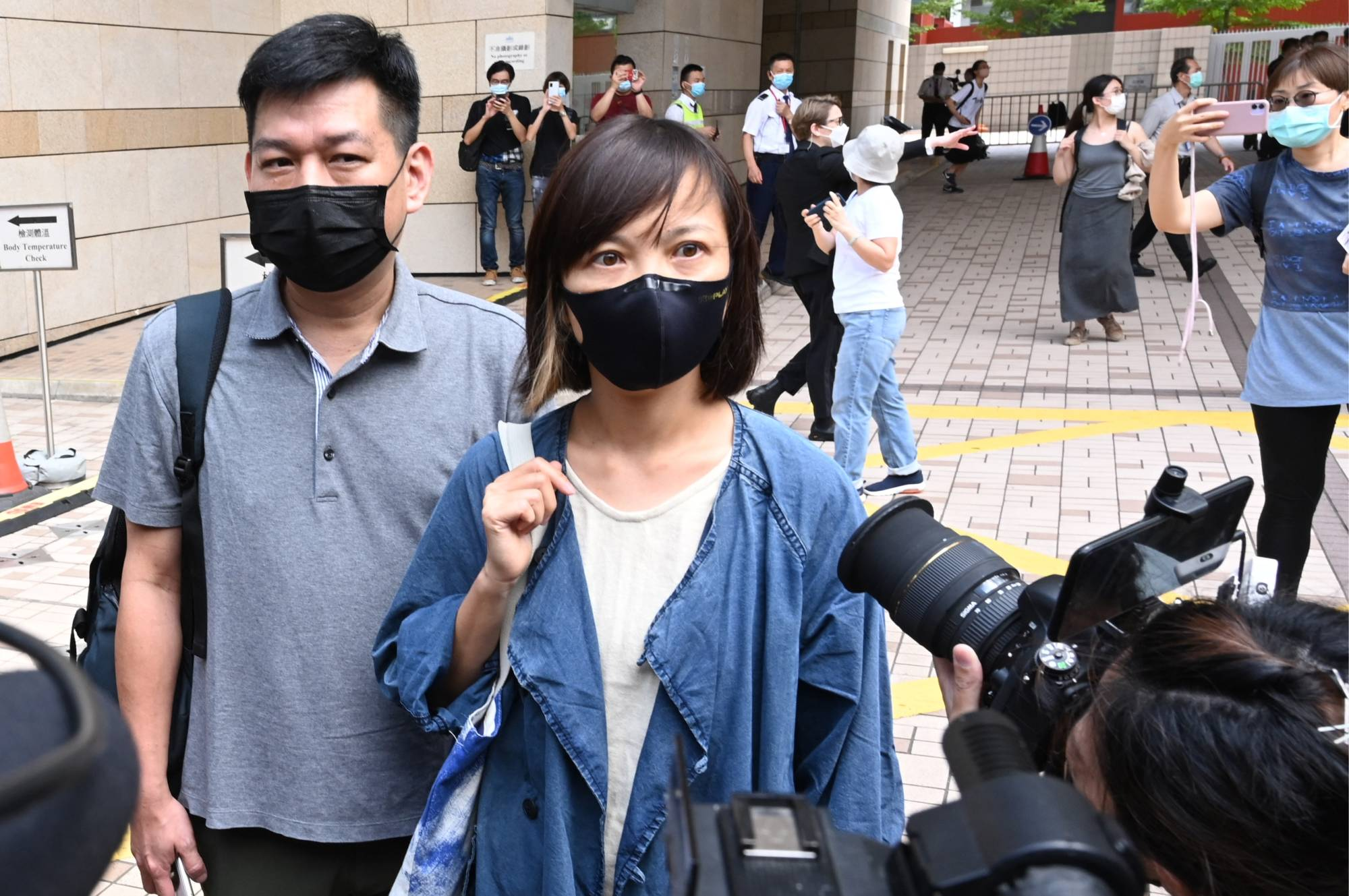 Apple Daily deputy chief editor Chan Pui-man speaks to the media as she leaves court in Hong Kong on Saturday. | AFP-JIJI