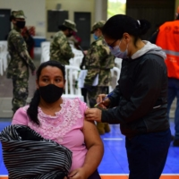 A pregnant woman receives a dose of Moderna's COVID-19 vaccine in Asuncion, Paraguay, on Saturday.