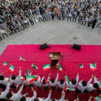Supporters of Ebrahim Raisi rally after his election victory, in Tehran on Saturday.    AFP-JIJI