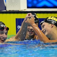 Katie Ledecky (left) reacts with Katie Grimes after winning in women's 800-meter freestyle finals during the U.S. Olympic Team Trials Swimming competition Saturday in Omaha, Nebraska.  | USA TODAY / VIA REUTERS