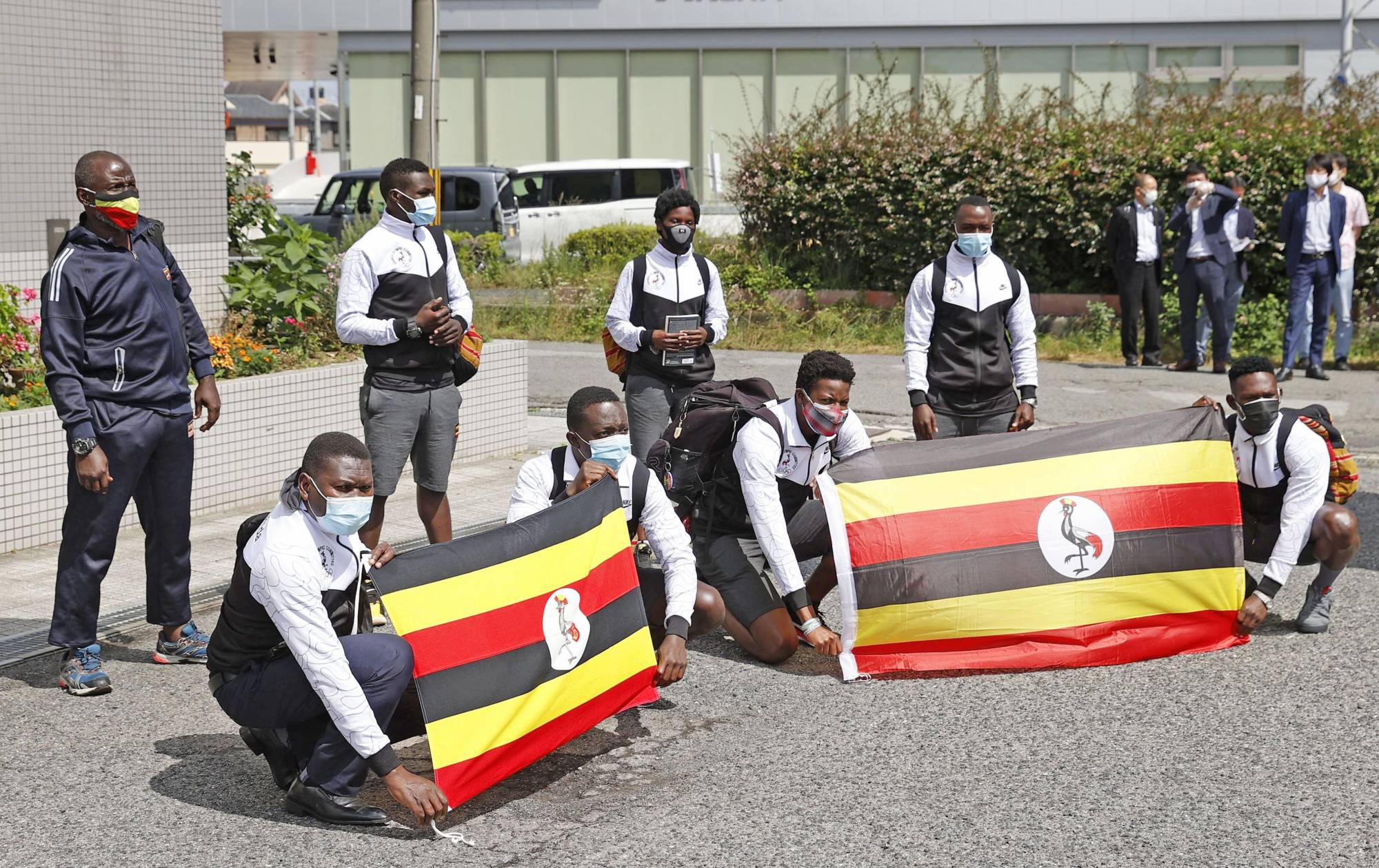 A group of Ugandan athletes arriving in Japan for the Tokyo Olympics are pictured in Izumisano, Osaka Prefecture, on Sunday.   KYODO