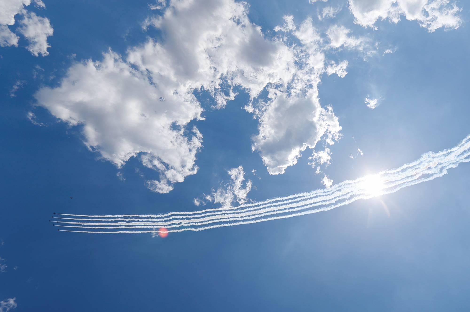 The Blue Impulse aerobatic team of the Air Self-Defense Force flies over the Self-Defense Forces Central Hospital to salute the medical workers at the front line of the fight against COVID-19 in Tokyo on May 29, 2020. | REUTERS