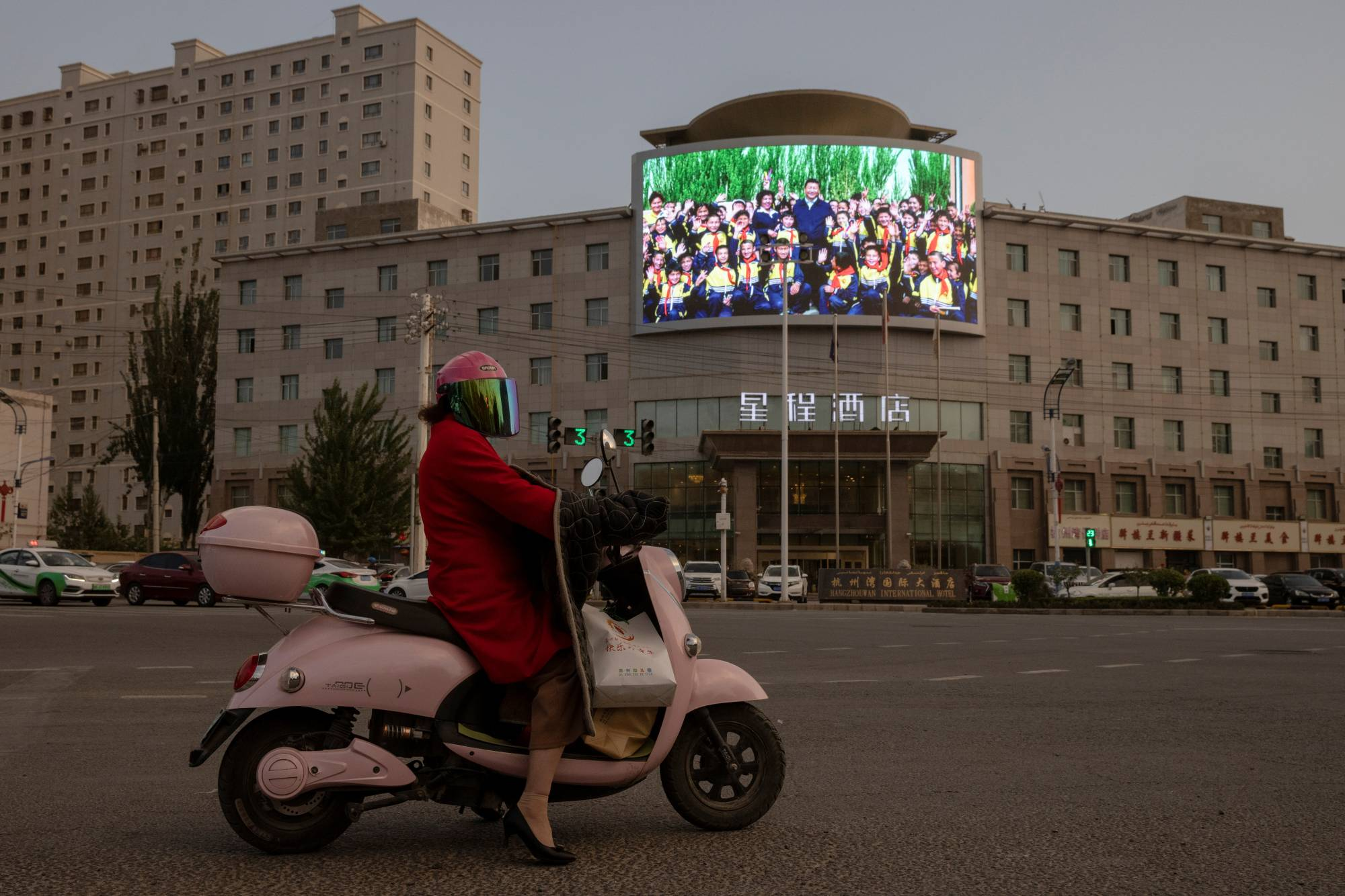 A screen shows a picture of Chinese leader Xi Jinping at a traffic junction in Hotan, in China's far-west Xinjiang region, on April 30.   REUTERS