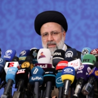 Iranian President-elect Ebrahim Raisi speaks during a news conference in Tehran on Monday.  | WEST ASIA NEWS AGENCY / VIA REUTERS