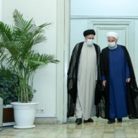 Iran's outgoing president, Hassan Rouhani, meets with President-elect Ebrahim Raisi in Tehran on Saturday.  | IRANIAN PRESIDENTIAL WEBSITE / VIA REUTERS