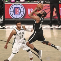 Brooklyn Nets guard James Harden shoots an off-balanced shot over Milwaukee Bucks forward Giannis Antetokounmpo in overtime during game seven in the second round of the 2021 NBA Playoffs at Barclays Center in Brooklyn, New York, on Saturday.   | USA TODAY / VIA REUTERS