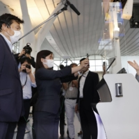 Tourism minister Kazuyoshi Akaba inspects border controls at Haneda Airport in Tokyo on June 4. | KYODO