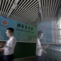 A government-sponsored advertisement promotes the national security law in Hong Kong in June 2020.    BLOOMBERG