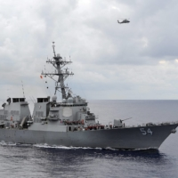 The U.S. Navy guided-missile destroyer USS Curtis Wilbur patrols in the Philippine Sea in 2013. | U.S. NAVY / VIA REUTERS