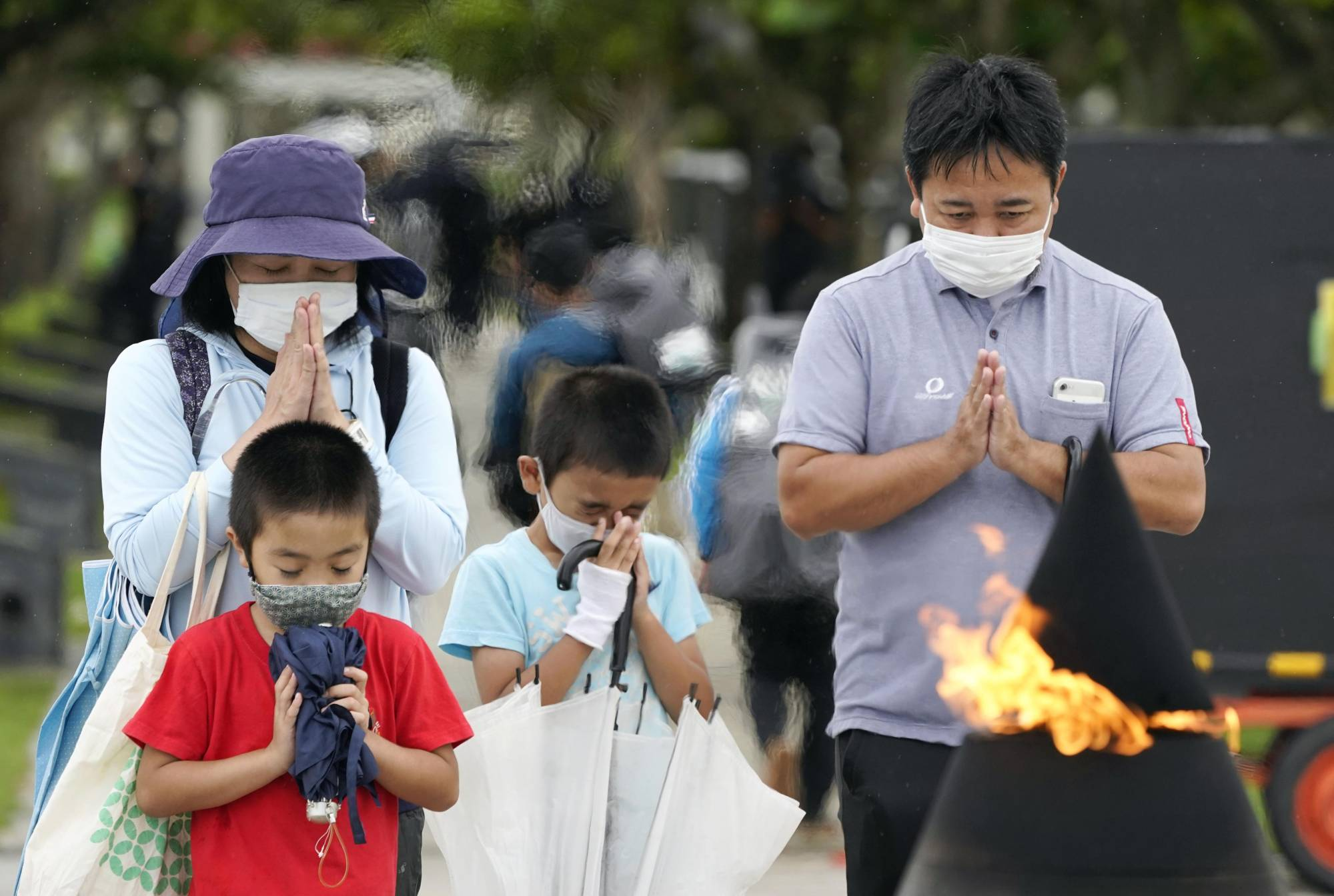 People pray at Peace Memorial Park in Itoman, Okinawa Prefecture, on Wednesday, the 76th anniversary of the end of the Battle of Okinawa. | KYODO