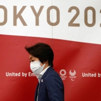 Tokyo Olympics Organising Committee President Seiko Hashimoto arrives at a news conference in Tokyo on Wednesday. | POOL / VIA REUTERS