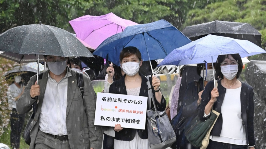 Japan's top court says forcing couples to share surname is constitutional