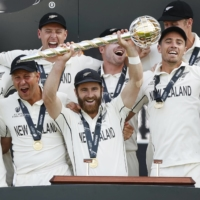 New Zealand captain Kane Williamson celebrates with his team after becoming the world test champions on Wednesday. | REUTERS