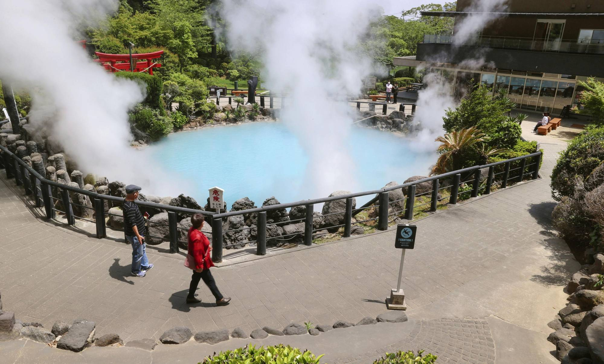 Tourists visit a hot spring in Beppu, Oita Prefecture, in May. | KYODO