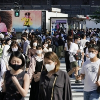 Tokyo confirmed 570 cases of new COVID-19 on Thursday. | KYODO