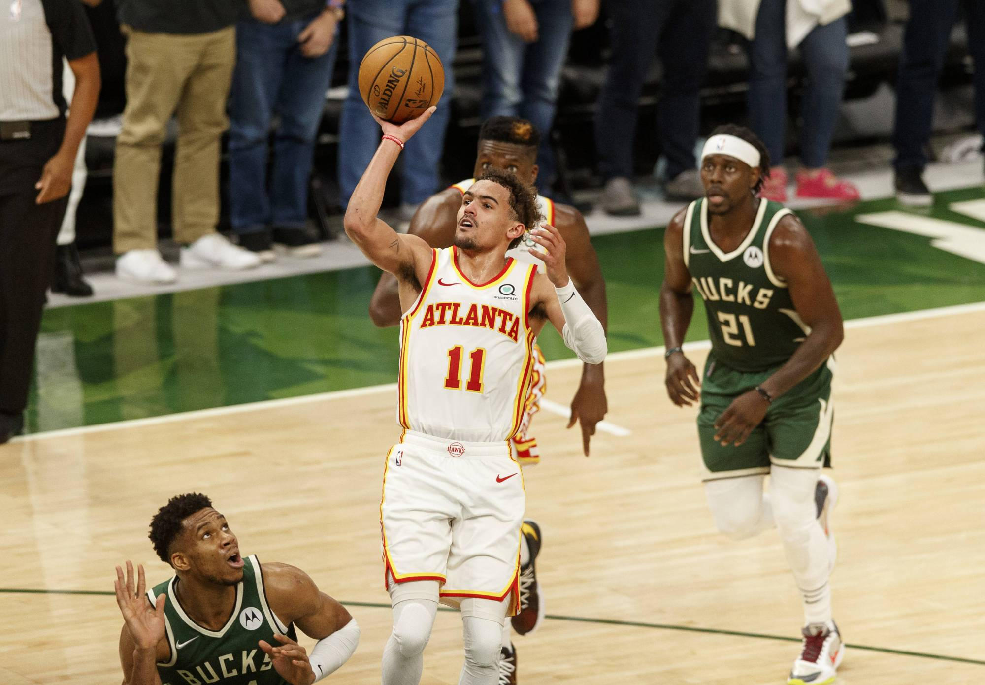 Hawks guard Trae Young attempts a shot against the Bucks during Game 1 of the Eastern Conference finals in Milwaukee on Wednesday.   USA TODAY / VIA REUTERS