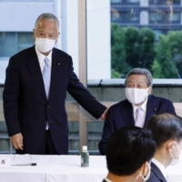 Former trade minister Akira Amari (left) attends a meeting of a parliamentary group on semiconductors, with Motoo Hayashi, an executive acting secretary-general, at the Liberal Democratic Party headquarters on June 15. | KYODO