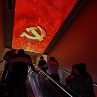 People visiting the museum of the First National Congress of the Chinese Communist Party in Shanghai on June 11.   AFP-JIJI