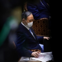 Prime Minister Yoshihide Suga attends a party leaders' debate at the Upper House of the Diet on June 9.  | BLOOMBERG