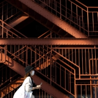 A woman walks next to a stairway entrance to Tokyo Tower. Tokyo confirmed 534 new cases of COVID-19 on Saturday, a significant increase from the 388 reported a week before.  | AFP-JIJI