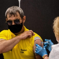 A man receives a dose of Russia's Sputnik V vaccine at a center in Moscow on Friday.  | AFP-JIJI