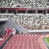 An Olympic test event for athletics is held at an empty National Stadium in Tokyo on May 9, with spectators not allowed due to the coronavirus pandemic. | KYODO
