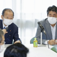 The expected electoral district realignment could affect some Liberal Democratic Party heavyweights, including Secretary-General Toshihiro Nikai (left) and former Prime Minister Shinzo Abe. | KYODO