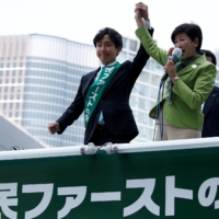 Tokyo Gov. Yuriko Koike (right) delivers a speech to voters from atop a campaign van during the June 2017 Tokyo Metropolitan Assembly election.    REUTERS