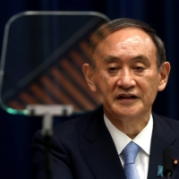 Prime Minister Yoshihide Suga during a news conference in May in Tokyo | POOL / VIA REUTERS