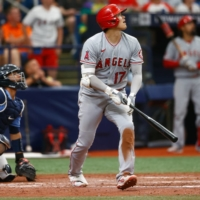 Los Angeles Angels designated hitter Shohei Ohtani hits a home run Sunday in the ninth inning against the Tampa Bay Rays, at Tropicana Field in St. Petersburg, Florida. | USA TODAY SPORTS / VIA REUTERS