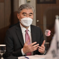 Sung Kim, U.S. special representative for North Korea, speaks with his South Korean counterpart during their bilateral meeting in Seoul on June 21. | POOL / VIA AFP-JIJI