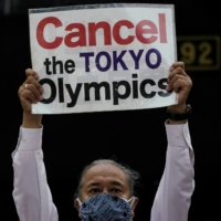 A protester attends a rally amid the ongoing COVID-19 outbreak in Tokyo in May.   REUTERS