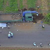 Two schoolchildren killed, three injured after drunk truck driver plows into group