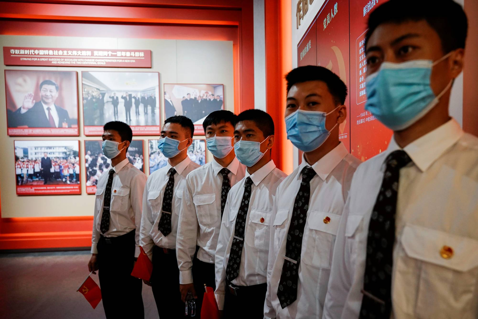 Security guards visit an exhibition at the Memorial of the First National Congress of the Communist Party of China in Shanghai. | REUTERS