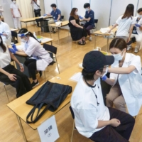 Students at Nihon University gets vaccinated in Tokyo's Chiyoda Ward on June 21. | KYODO