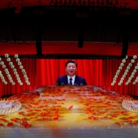 Chinese President Xi Jinping appears on a giant screen during a show commemorating the 100th anniversary of the founding of China's Communist Party in Beijing on Monday.   | REUTERS
