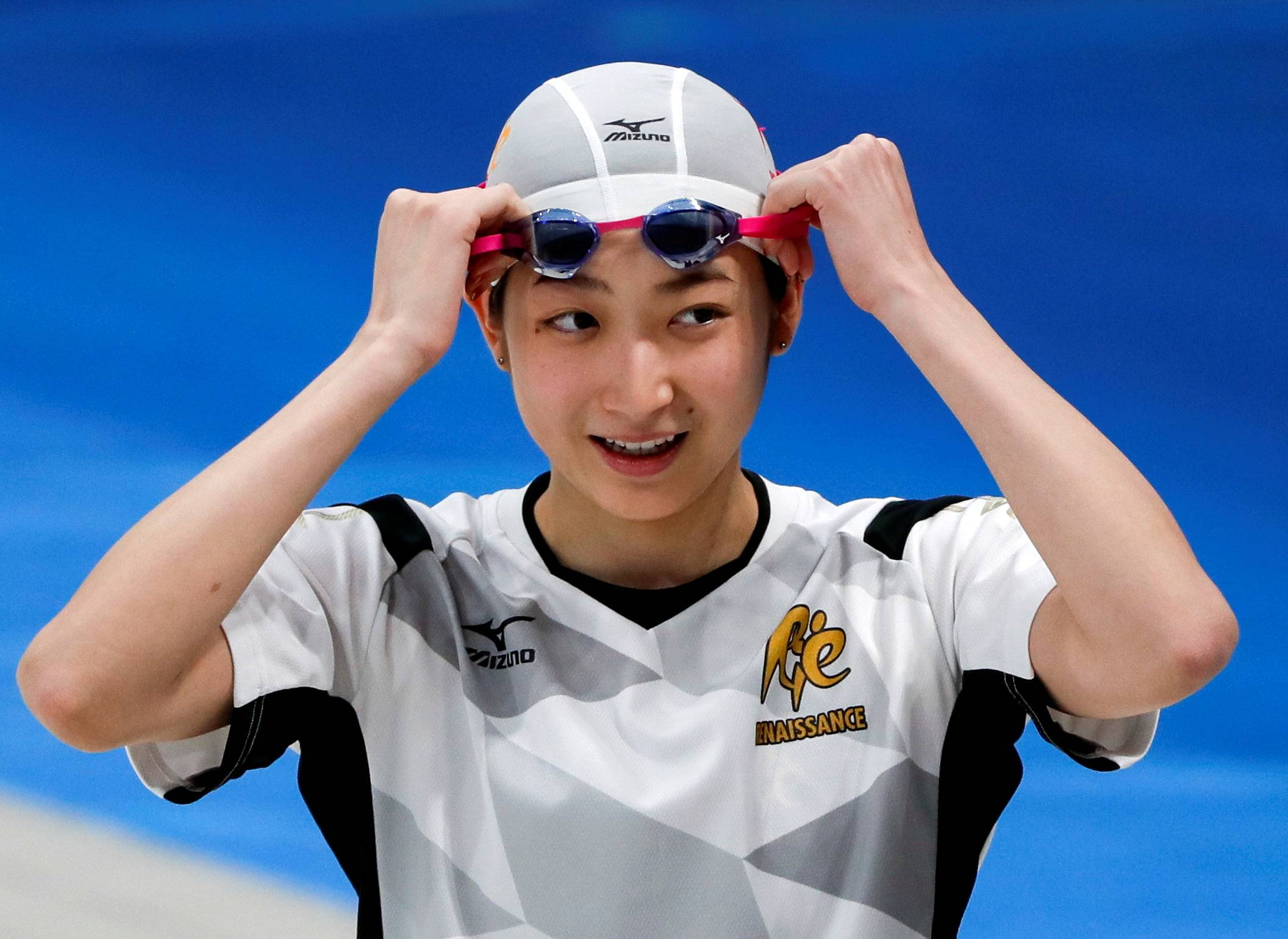 Swimming star Rikako Ikee revealed in May that she had received messages on her social media accounts telling her to pull out of the games. | REUTERS